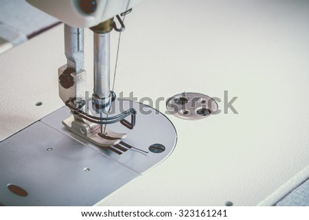 Abstract Sewing machine and thread rolling. - stock photo