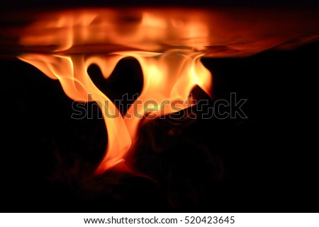 Abstract shape of fire heart isolated on black background