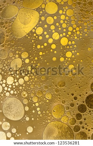 Abstract shapes like some yellow cells, mixture of oil and water - stock photo