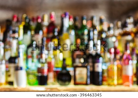 Abstract shelves with different bottles of alcohol