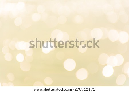 Abstract shining yellow bokeh background. - stock photo