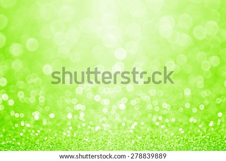 Abstract shiny green glitter sparkle background - stock photo