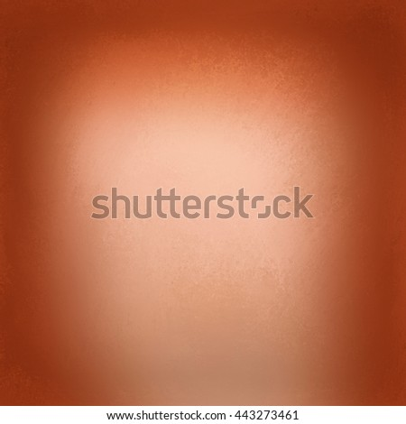 abstract shiny orange background with blurred texture, brown tinted border with soft peach center, blurry orange halloween autumn or thanksgiving background - stock photo