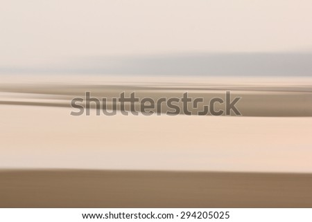 Abstract shore tones from panning camera movement - stock photo