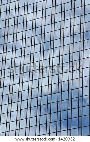 Abstract shot of the reflecting sky on the outside wall of a modern office building