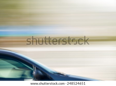Abstract side take of a speeding car - stock photo
