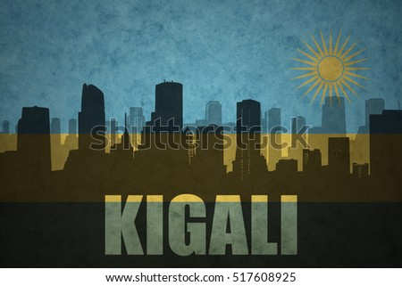 abstract silhouette of the city with text Kigali at the vintage rwandan flag background