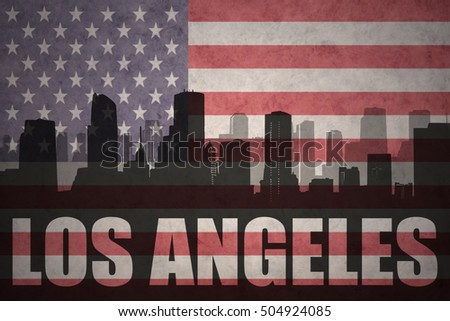 abstract silhouette of the city with text Los Angeles at the vintage american flag background