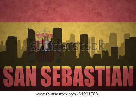 abstract silhouette of the city with text San Sebastian at the vintage spanish flag background