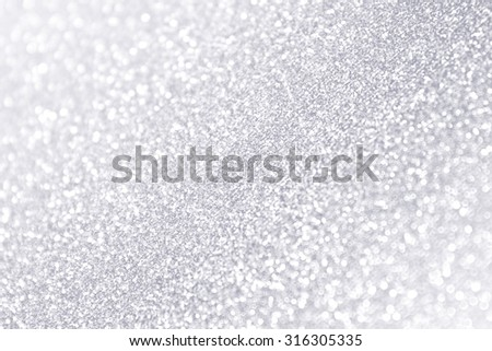Abstract silver and white sparkle glitter background - stock photo