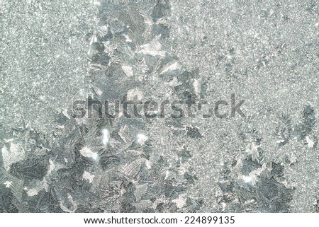 abstract silver background from a frosty pattern on glass - stock photo