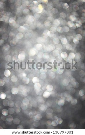 abstract silver glitter lights - stock photo