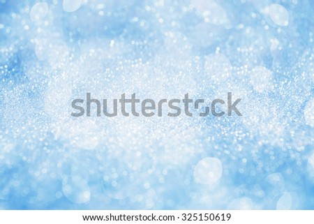 Abstract silver light on blue blurred background - stock photo