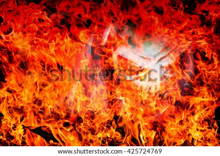 abstract skull demon on blaze fire flame texture on gradient shade for background use , high resolution - can use to display or montage product - stock photo