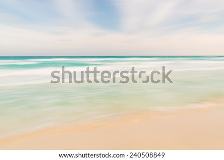 Abstract sky, ocean and beach nature background with blurred panning motion. - stock photo