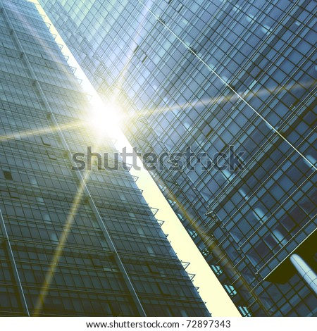 Abstract skyscrapers with sun glare - stock photo