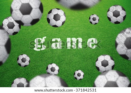 Abstract soccer field with many soccer balls and game word caption. Blurred and grunge textured soccer balls on green football field background. Selective focus used. Conceptual soccer background.