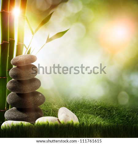 Abstract spa backgrounds with bamboo and pebble - stock photo
