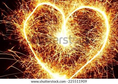 Abstract sparkler motion heart shape texture. - stock photo