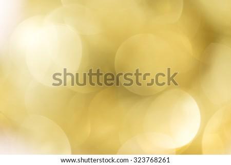 Abstract sparkling defocused  light  bokeh  on gold background  - stock photo