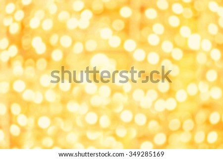 Abstract Sparkling Golden lights with bokeh effect. Splashes of champagne - stock photo