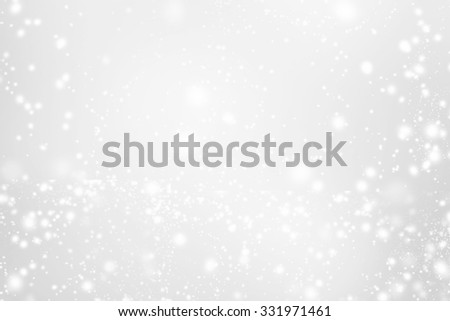 Abstract Sparkling Merry Christmas card with white and silver   lights. Festive  background with Falling Snow and stars. Poster, Banner, Ad, Card or invitation. - stock photo