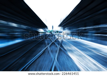 Abstract speed motion blur railway track at train station.  - stock photo