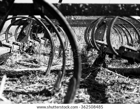 Abstract Spirals--Old Rusty Farm Equipment. - stock photo