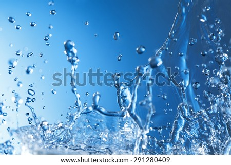 Abstract Splash of Water on a Blue Background - stock photo