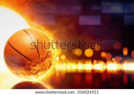 Abstract sports background - burning basketball, orange glowing lights with reflection - stock photo