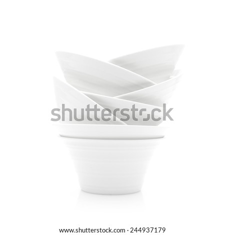 Abstract Stack of White Dishes on a White Background - stock photo