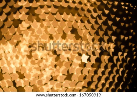 Abstract star shaped bokeh background of white Christmas lights - stock photo