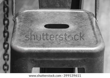 Abstract steel chair vintage image black and white - stock photo