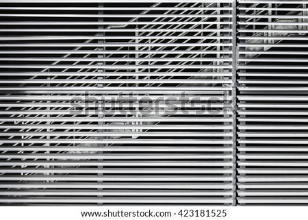 Abstract steel constructions, modern industrial architecture fragment, stairs behind shutters - stock photo