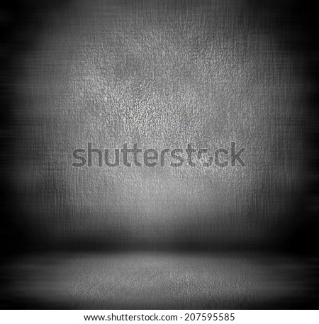Abstract stonework background texture with old weathered dark stucco black paint stone cement wall in rural room. Grungy cold rock surface in hard grime empty place with gray granite dull light floor. - stock photo