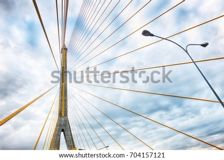 Abstract structural of bridge against cloud sky
