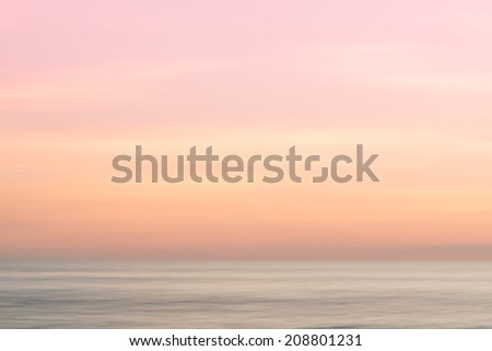 Abstract sunrise sky and  ocean nature background with blurred panning motion. - stock photo