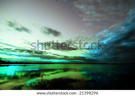 Abstract sunset in green, blue, grey - stock photo