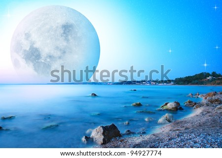 Abstract sunset landscape with big moon on sea cost. - stock photo