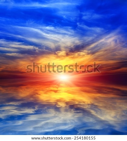 Abstract sunset over water reflection - stock photo