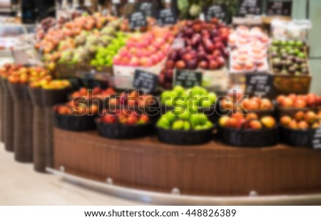 Abstract supermarket on fruit shelf blurred background with bokeh in shopping mall.