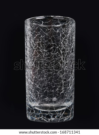 abstract surface of broken glass on black background - stock photo