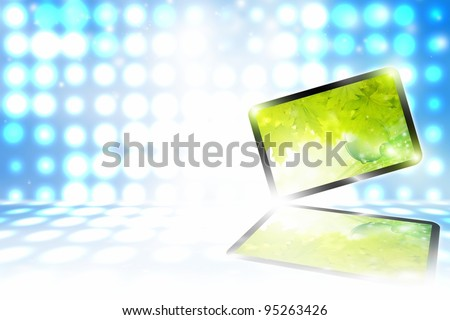 Abstract tablet PC on blue background with bright lights