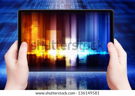 Abstract tablet pc with equalizer on screen in hands, multimedia gadget