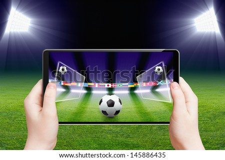 Abstract technology background - tablet pc, computer in hands, soccer ball, sports game online, soccer online, augmented reality - stock photo
