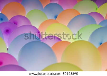 abstract texture background of backlit colorful ballons in different sizes - stock photo