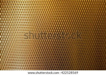 Abstract texture golden metal cylindrical shape with reflections useful for backgrounds - stock photo