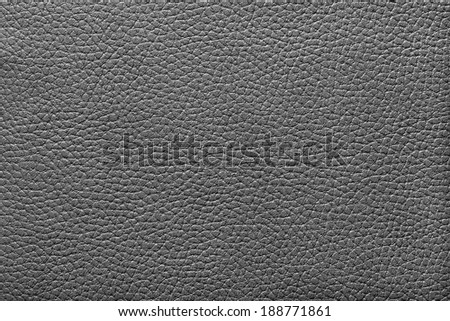 abstract texture of artificial leather fabric for a background and for wallpaper of black color - stock photo