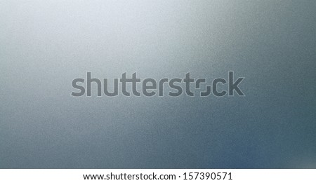 Abstract texture of grey and light blue smooth brushed metal background - stock photo