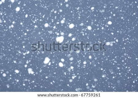 abstract texture with snow falling
